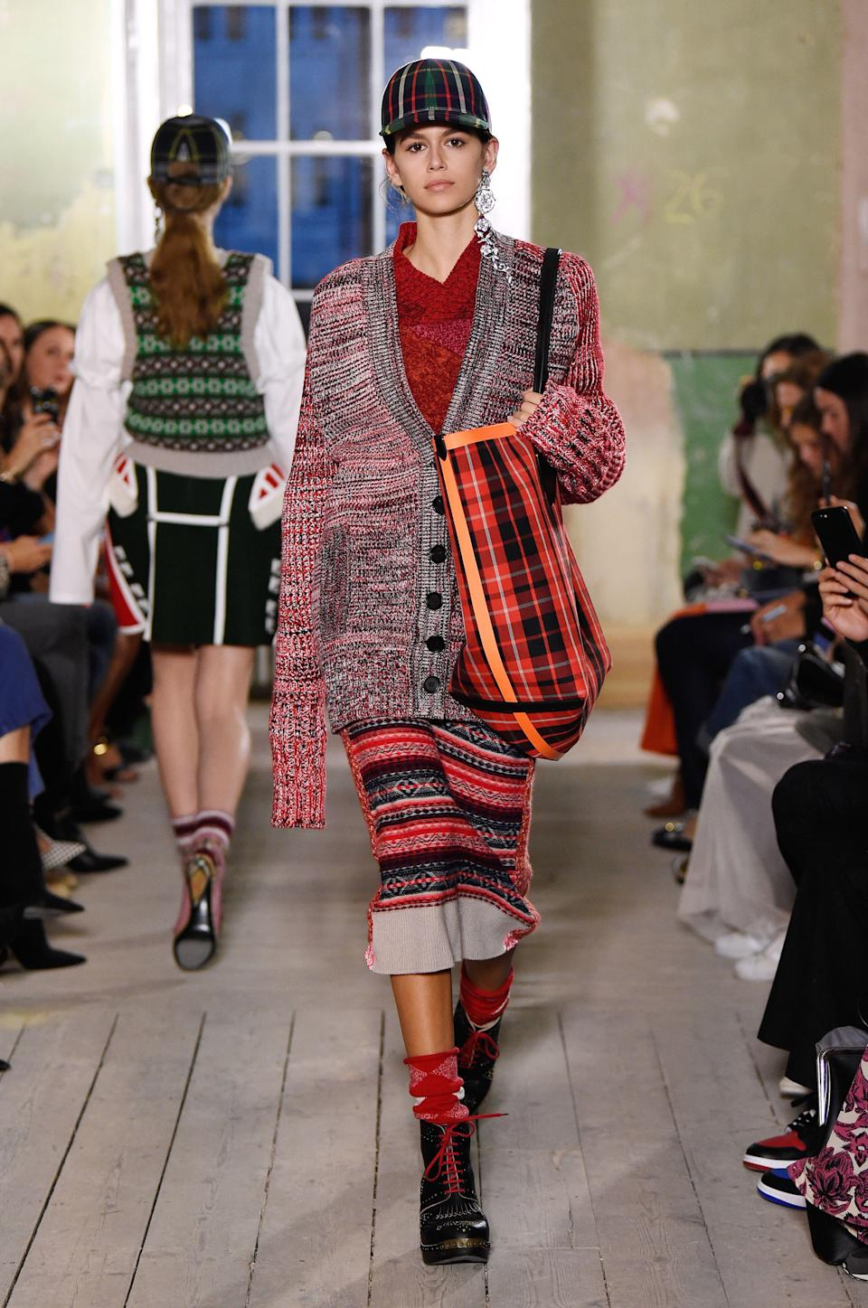 <p>The 16-year-old model made her first London appearance at Burberry's stand-out show.<br><i>[Photo: Rex]</i> </p>
