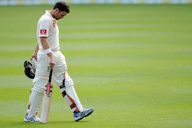 Ed Cowan of Australia looks dejeted as he leaves the field during day four of the First Test match between Australia and South Africa at The Gabba on November 12, 2012 in Brisbane, Australia.  (Photo by Matt Roberts/Getty Images)