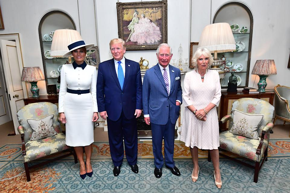 US President Donald Trump and his wife Melania (left) at Clarence House in London to take tea with the Prince of Wales and Duchess of Cornwall on the first day of his state visit to the UK.