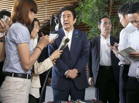 Japan's Prime Minister Shinzo Abe speaks to media at his official residence in Tokyo
