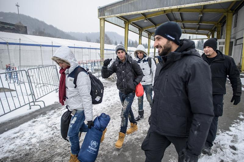 Refugees and migrants walk to cross the Slovenian-Austrian border on January 5, 2016 in Sentilj