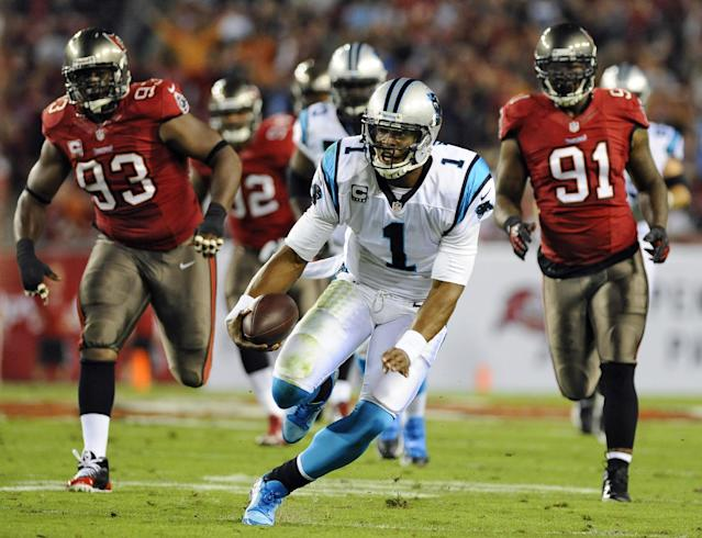 Carolina Panthers quarterback Cam Newton (1) rushes past Tampa Bay Buccaneers defensive tackle Gerald McCoy (93) and defensive end Da'Quan Bowers (91) during the first quarter of an NFL football game on Thursday, Oct. 24, 2013, in Tampa, Fla. (AP Photo/Brian Blanco)