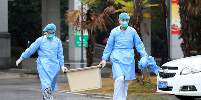 Medical staff carry a box as they walk at the Jinyintan hospital, where coronavirus patients are being treated, in Wuhan, Hubei province, China January 10, 2020.