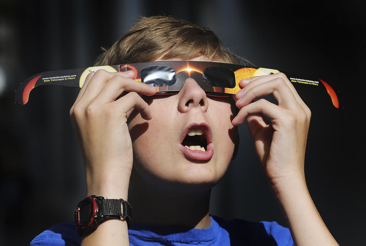 <p>In this Wednesday, Aug. 16, 2017 photo, Colton Hammer tries out his new eclipse glasses he just bought from the Clark Planetarium in Salt Lake City, Utah, in preparation for the eclipse. (Photo: Scott G Winterton/The Deseret News via AP) </p>