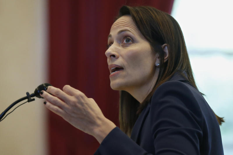 Sabrina Strong, an attorney for Johnson & Johnson and its subsidiaries, gestures as she speaks during a hearing to settle disagreements between Johnson & Johnson and the State over Judge Thad Balkman's final judgement in the opioid lawsuit, Tuesday, Oct. 15, 2019 in Norman, Okla. (AP Photo/Sue Ogrocki)