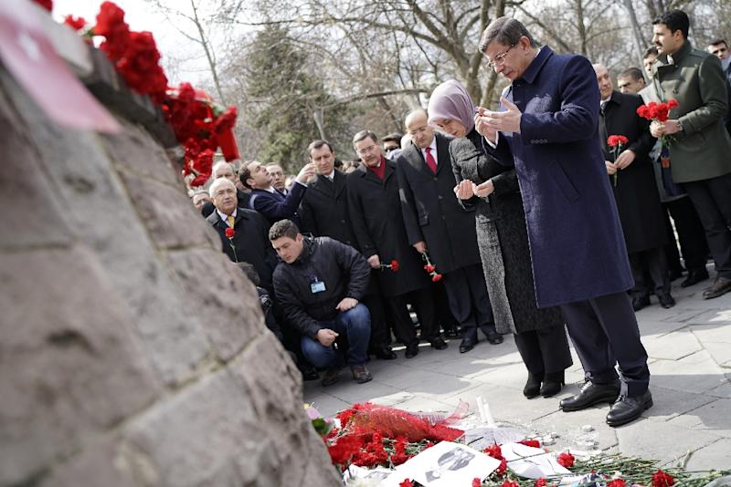 Turkish Prime Minister Ahmet Davutoglu and his wife pay their respects to the victims of the Ankara terror attack on March 17, 2016 (AFP Photo/Umit Bektas)