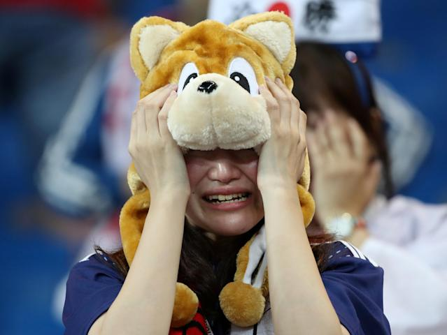 <p>Japan fan looks dejected after the match REUTERS/Marko Djurica </p>