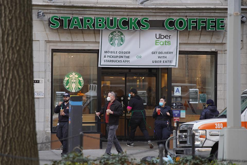 NEW YORK, NEW YORK,  - APRIL 14: A Starbucks remains open for take-out during the coronavirus pandemic on April 14, 2020 in New York City. Shelter-In-Place and social distancing continues across the city, emptying streets and businesses to curb the spread of the coronavirus, COVID-19. (Photo by Rob Kim/Getty Images)