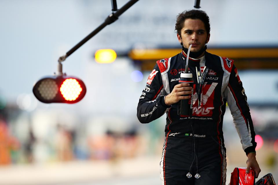 ABU DHABI, UNITED ARAB EMIRATES - DECEMBER 12: Pietro Fittipaldi of Brazil and Haas F1 walks in the Pitlane during qualifying ahead of the F1 Grand Prix of Abu Dhabi at Yas Marina Circuit on December 12, 2020 in Abu Dhabi, United Arab Emirates. (Photo by Mark Thompson/Getty Images)