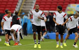 Germany's Jerome Boateng, center, warms up with teammates during a training session at the Estadio Beira-Rio Stadium in Porto Alegre, Brazil, Sunday, June {try}, 2014. Germany will play Algeria in a World Cup round of 16 soccer match on June 30. (AP Photo/Frank Augstein)