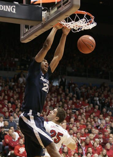 Xavier's Jeff Robinson (21) dunks past Dayton's Alex Gavrilovic (35) during the first half of an NCAA college basketball game on Saturday, Jan. 21, 2012 in Dayton, Ohio. (AP Photo/Skip Peterson)