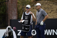 Shawn Spieth, left, caddies for his son Jordan Spieth during the first round of the Zozo Championship golf tournament Thursday, Oct. 22, 2020, in Thousand Oaks, Calif. (AP Photo/Marcio Jose Sanchez)