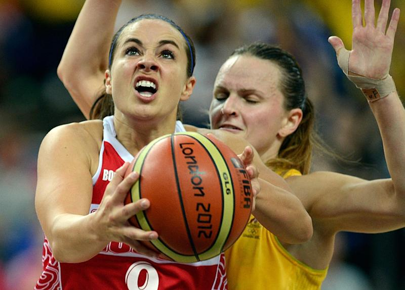 Australian guard Jennifer Screen (back) challenges Russian guard Becky Hammon during the London 2012 Olympic Games women's bronze medal basketball game between Australia and Russia at the North Greenwich Arena in London on August 11, 2012