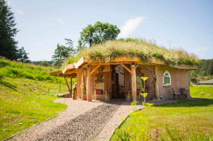 "<p>Escape the woes of everyday with a stay at the Hobbit Hideaway in Moray, Scotland. Described as being like a 'giant hug', it has been built using locally-sourced recycled materials including stone, earth, clay, straw bales and recycled treasures. It really is a unique eco home with stacks of character.</p><p><a class=""link rapid-noclick-resp"" href=""https://airbnb.pvxt.net/rnQ6jG"" rel=""nofollow noopener"" target=""_blank"" data-ylk=""slk:BOOK NOW"">BOOK NOW</a></p>"