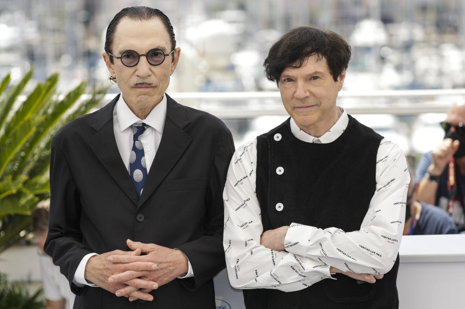 Ron Mael, left, and Russell Mael pose for photographers at the photo call for the film Annette at the 74th international film festival, Cannes, southern France, Tuesday, July 6, 2021. (Photo by Vianney Le Caer/Invision/AP)