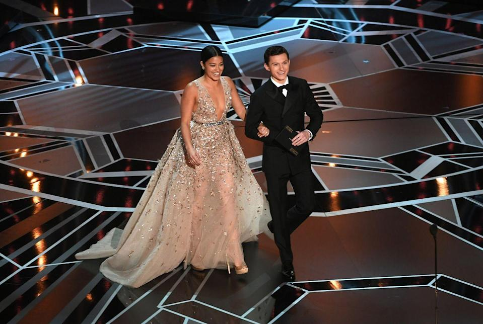 <p>Gina Rodriguez and Tom Holland speak onstage during the 90th Annual Academy Awards at the Dolby Theatre at Hollywood & Highland Center on March 4, 2018 in Hollywood, California.</p>