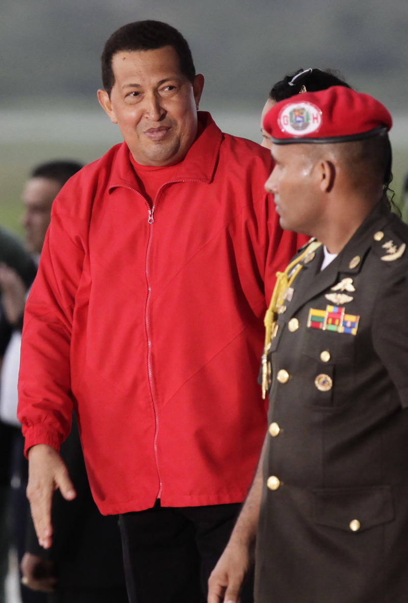Venezuela's President Hugo Chavez departs for Cuba from the Simon Bolivar international airport in Maiquetia on the outskirts of Caracas, Venezuela, Saturday July 16, 2011. Chavez left home Saturday for Cuba to begin chemotherapy, vowing to win his fight against cancer and calling for his political allies to stay united in his absence. Earlier in the day, Chavez announced he was delegating some of his duties to his vice president and finance minister as he prepared to fly to Cuba.  (AP Photo/Ariana Cubillos)