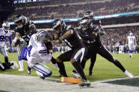 Dallas Cowboys quarterback Dak Prescott (4) is pushed out of bounds by Philadelphia Eagles defensive end Chris Long (56) and cornerback Ronald Darby (21) during the first half of an NFL football game, Sunday, Nov. 11, 2018, in Philadelphia. (AP Photo/Matt Slocum)