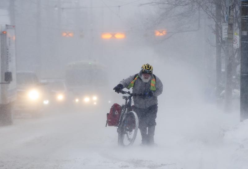 <p>A man named Marek Wiechula pushes his bicycle during a 15-kilometre ride through Toronto on Jan. 28, 2019. Photo from The Canadian Press. </p>