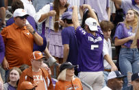A TCU fan gestures toward Texas fans during the first half of an NCAA college football game Saturday, Oct. 2, 2021, in Fort Worth, Texas. (AP Photo/Ron Jenkins)