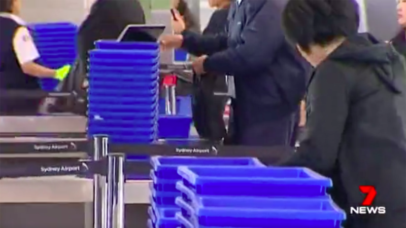 Airport security trays spreading germs, study says