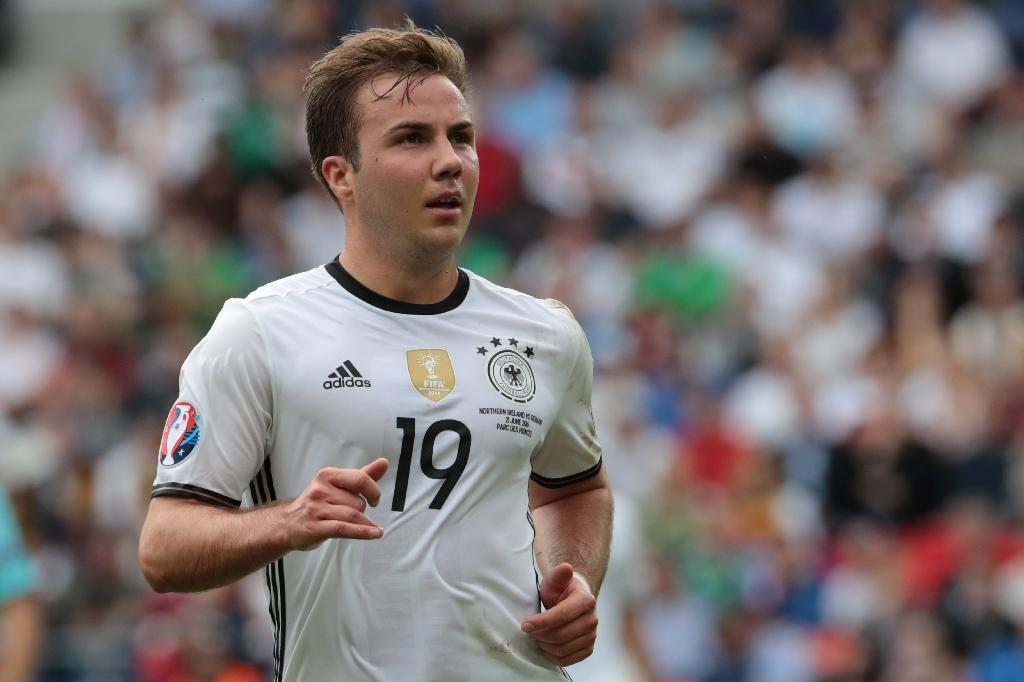 Germany's World Cup-winner Mario Goetze is poised to play for the first time in seven months for Borussia Dortmund at Wolfsburg on Saturday to end his illness misery (AFP Photo/KENZO TRIBOUILLARD)