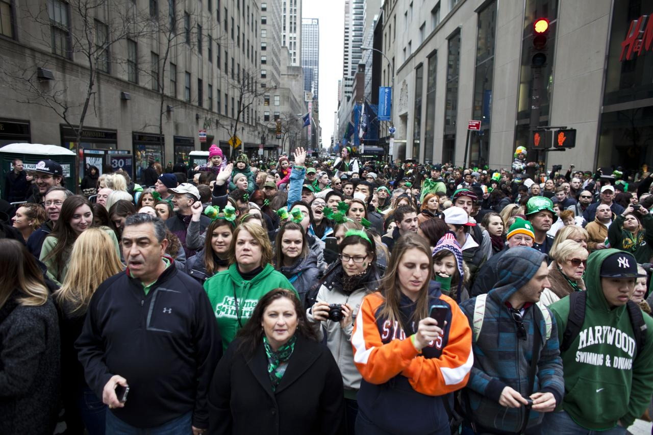 NEW YORK, NY - MARCH 16: Revelers watch the 252nd annual St. Patrick's Day Parade March 16, 2013 in New York City. The parade honors the patron saint of Ireland and was held for the first time in New York on March 17, 1762, 14 years before the signing of the Declaration of Independence. (Photo by Ramin Talaie/Getty Images)