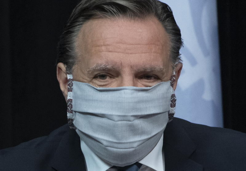 Quebec Premier Francois Legault arrives at a news conference on the COVID-19 pandemic wearing a mask, Tuesday, May 12, 2020 at the legislature in Quebec City. (Jacques Boissinot/The Canadian Press via AP)
