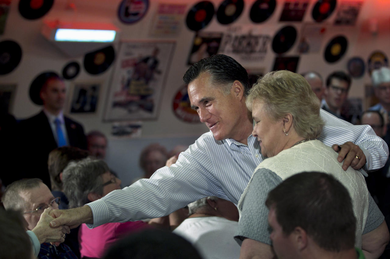 Republican presidential candidate, former Massachusetts Gov. Mitt Romney greets people during a campaign stop at Charlie Parker's Diner in Springfield, Ill., Monday, March 19, 2012. (AP Photo/Steven Senne)