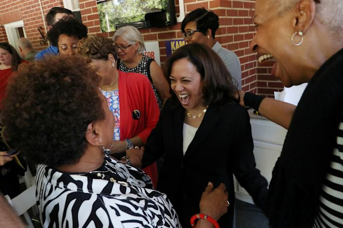 Harris shares a moment with old friend Rep. Barbara Lee and Carlottia Scott at a campaign event in Columbia, S.C., last month. (Photo: Leah Millis/Reuters)
