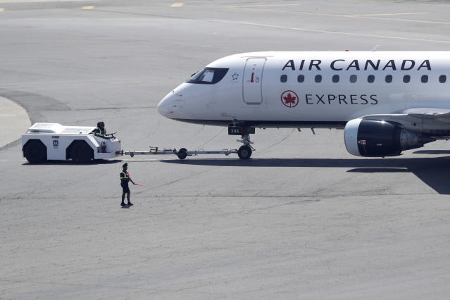 An Air Canada jet taxis at Newark Liberty International Airport, Wednesday, May 2, 2018, in Newark, N.J. (AP Photo/Julio Cortez)
