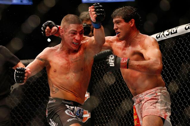 Despite what looked like a wild brawl with Diego Sanchez (L), Gilbert Melendez (R) said there was a lot of strategy in that fight. He said he'll try to explain that strategy to viewers in his new ESPN show. (Getty Images)