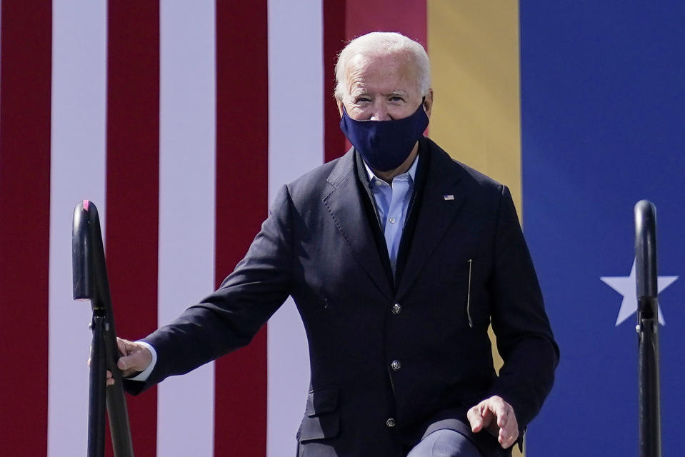 Democratic presidential candidate former Vice President Joe Biden step on stage to speak during a campaign event at Riverside High School in Durham, N.C., Sunday, Oct. 18, 2020. (AP Photo/Carolyn Kaster)