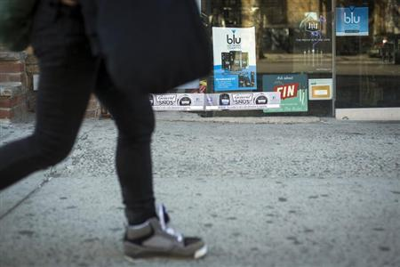 A pedestrian walks past advertisements for e-cigarettes in New York