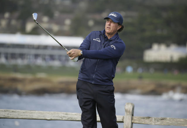 Phil Mickelson follows his shot from the seventh tee of the Pebble Beach Golf Links during the third round of the AT&T Pebble Beach Pro-Am golf tournament Saturday, Feb. 9, 2019, in Pebble Beach, Calif. (AP Photo/Eric Risberg)