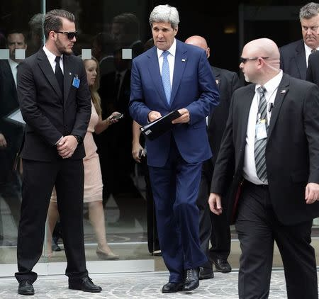 U.S. Secretary of State John Kerry leaves a meeting at a hotel in Vienna July 14, 2014. REUTERS/Heinz-Peter Bader