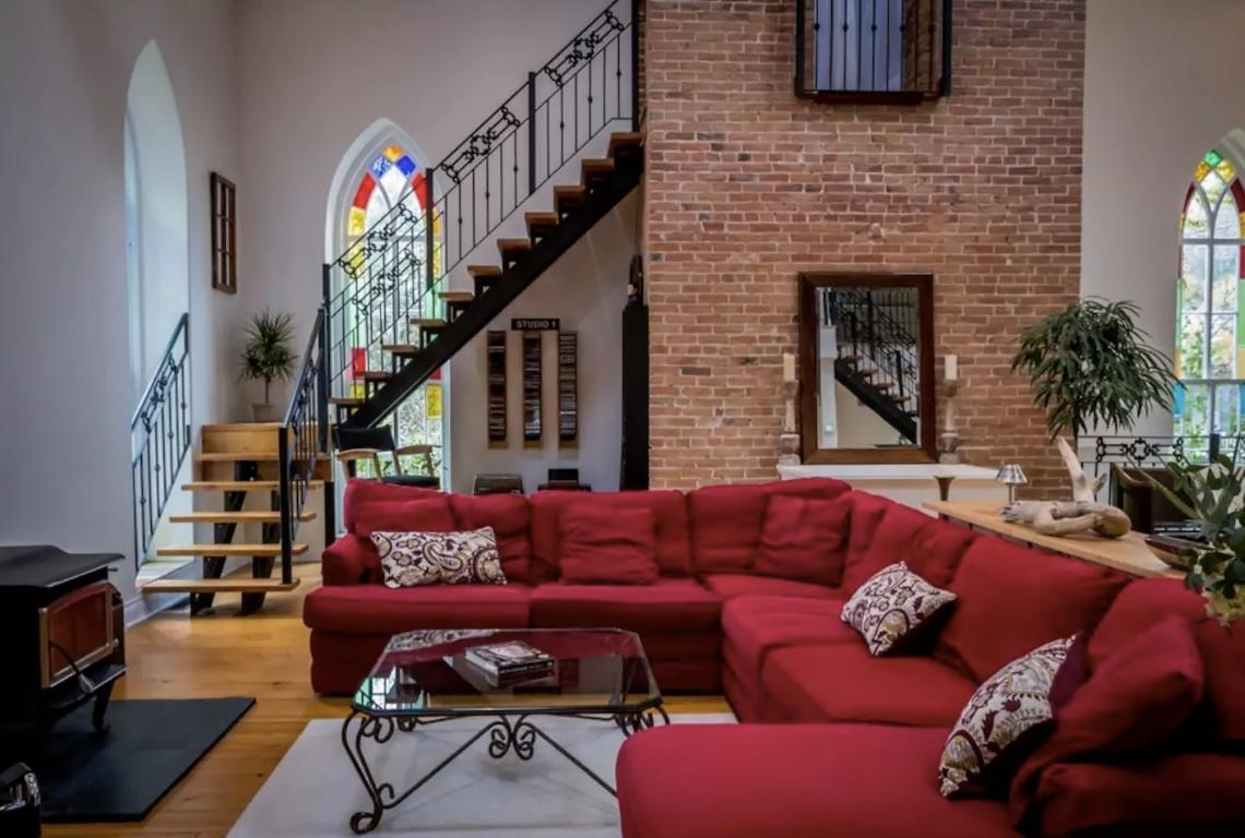 "<p>The ""Manilla Church"" has four bedrooms and 5000 square feet. The open-concept design highlights the 30-foot ceilings, Douglas Firm beams and stain-glass windows. </p>"