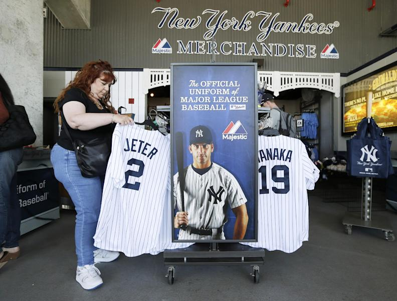 Elaine Rosenkranz, from Galloway, New Jersey, looks at a Derek Jeter jersey after watching a New York Yankees spring training baseball practice Tuesday, Feb. 18, 2014, in Tampa, Fla. (AP Photo/Charlie Neibergall)