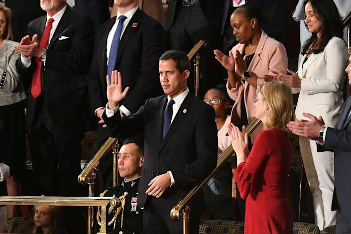 Venezuelan opposition leader Juan Guaidó waves as he is acknowledged by President Trump during the State of the Union address. (Mandel Ngan/AFP via Getty Images)