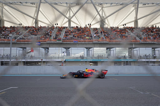 Red Bull driver Max Verstappen of the Netherland's steers his car during the third free practice at the Yas Marina racetrack in Abu Dhabi, United Arab Emirates, Saturday, Nov. 30, 2019. The Emirates Formula One Grand Prix will take place on Sunday. (AP Photo/Hassan Ammar)