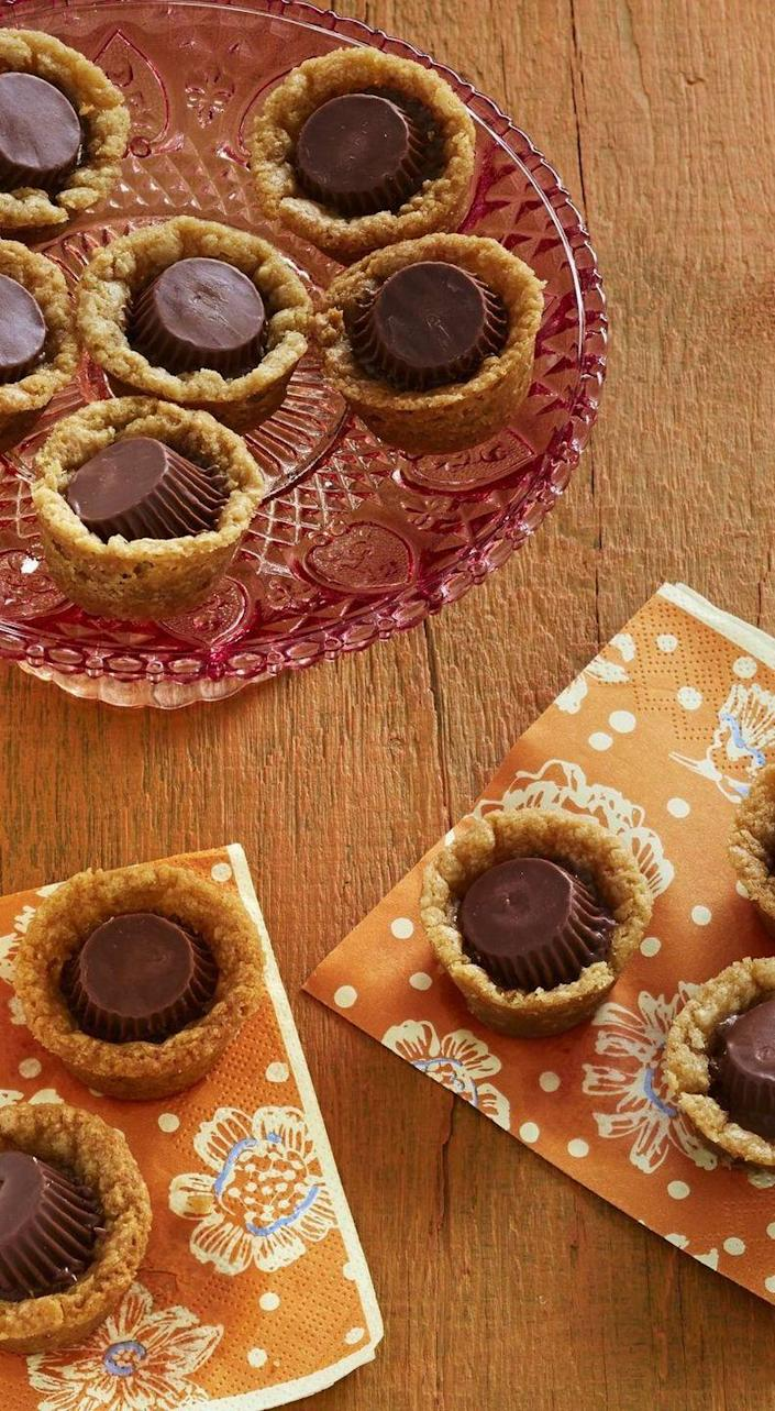 """<p>Use refrigerated peanut butter or sugar cookie dough to quickly make these little bites of goodness. </p><p><a href=""""https://www.thepioneerwoman.com/food-cooking/recipes/a34029810/quick-peanut-butter-chocolate-cookies-recipe/"""" rel=""""nofollow noopener"""" target=""""_blank"""" data-ylk=""""slk:Get Ree's recipe."""" class=""""link rapid-noclick-resp""""><strong>Get Ree's recipe.</strong></a> </p>"""