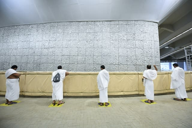 Muslim pilgrims cast stones at a pillar in the symbolic stoning of the devil (Saudi Ministry of Media via AP)