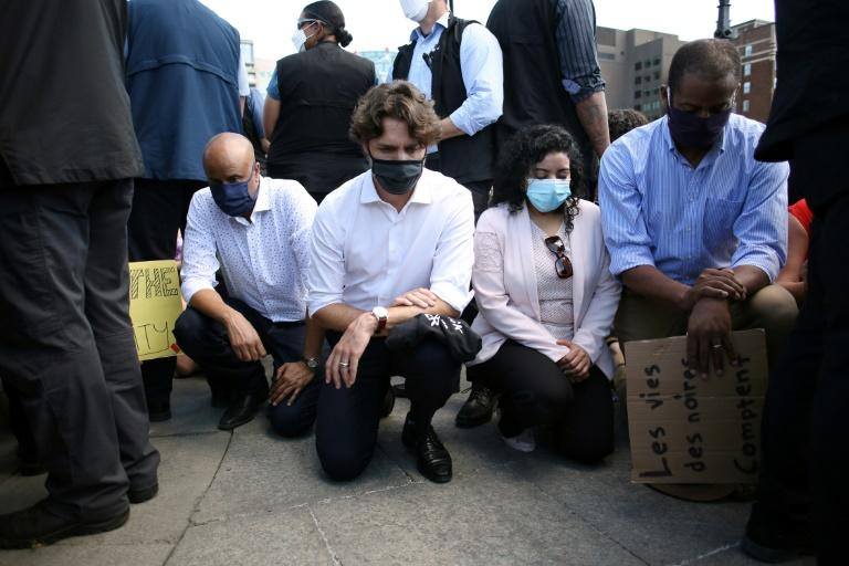 Canadian Prime Minister Justin Trudeau (2nd L) takes a knee during a Black Lives Matter protest on Parliament Hill on June 5, 2020 in Ottawa (AFP Photo/Dave Chan)