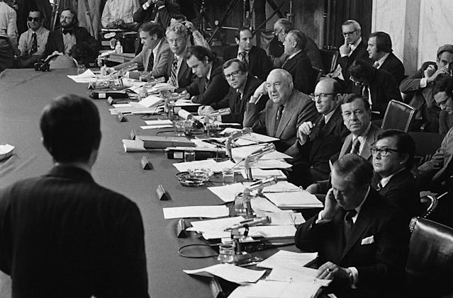 <p>Members of the Senate Watergate Investigating Committee are seen during a hearing on Capitol Hill in Washington as they listen to witness Robert Odle, foreground, on May 17, 1973. From left are; Sen. Lowell Weicker, R-Conn.; Sen. Edward Gurney, R-Fla.; Chief Minority Counsel Fred Thompson; Sen. Howard Baker, R-Tenn.; Sen. Sam Ervin, D-N.C.; chairman and chief counsel Samuel Dash; Sen. Herman Talmadge, D-Ga., Sen. Daniel Inouye, D-Hawaii and Sen. Joseph Montoya, D-N.M. Thompson gained an image as a tough-minded investigative counsel for the Senate Watergate committee. Yet President Nixon and his top aides viewed the fellow Republican as a willing, if not too bright, ally, according to White House tapes. (Photo: AP) </p>