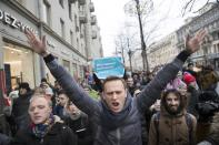 FILE - In this Sunday, Jan. 28, 2018 file photo, Russian opposition leader Alexei Navalny, center, attends a rally in Moscow, Russia. Novichok, a deadly nerve agent that has left Russian opposition politician Alexei Navalny in a coma and nearly killed a former Russian spy and his daughter in 2018, was the product of a highly secretive Soviet chemical weapons program. Just a few milligrams of the odorless liquid — the weight of a snowflake — are enough to kill a person within minutes. (AP Photo/Evgeny Feldman, File)