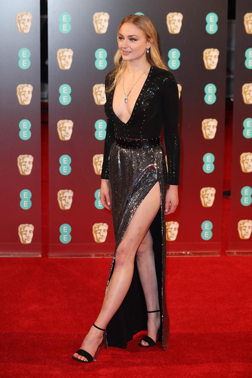<p>The <i>Game of Thrones</i> star showed some serious leg in a black-and-silver Louis Vuitton gown. <i>[Photo: Getty]</i> </p>