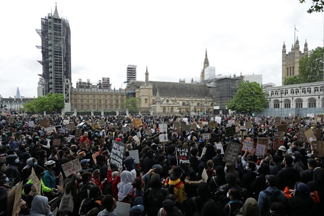 Protesters gather in Parliament Square on Sunday. (ISABEL INFANTES/AFP via Getty Images)