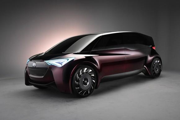 Toyota's Fine-Comfort Ride concept vehicle, a boxy purple four-door shaped somewhat like a minivan.