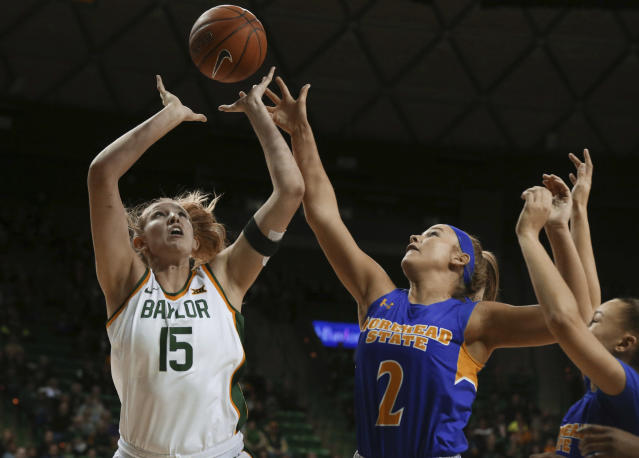 Baylor forward Lauren Cox, left, reaches for a rebound with Morehead State forward Ellie Jo Johnson (2) in the first half of an NCAA college basketball game, Monday, Dec. 30, 2019, in Waco, Texas. (Rod Aydelotte/Waco Tribune Herald, via AP)/Waco Tribune-Herald via AP)