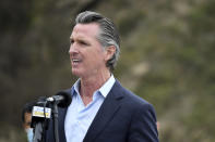 FILE - In this April 23, 2021, file photo, California Gov. Gavin Newsom speaks during a press conference about the newly reopened Highway 1 at Rat Creek near Big Sur, Calif. Organizers of the recall effort against Gov. Newsom collected enough valid signatures to qualify for the ballot. The California secretary of state's office announced Monday, April 26, 2021 that more than 1.6 million signatures had been verified, about 100,000 more than needed to force a vote on the first-term Democrat. (AP Photo/Nic Coury, File)